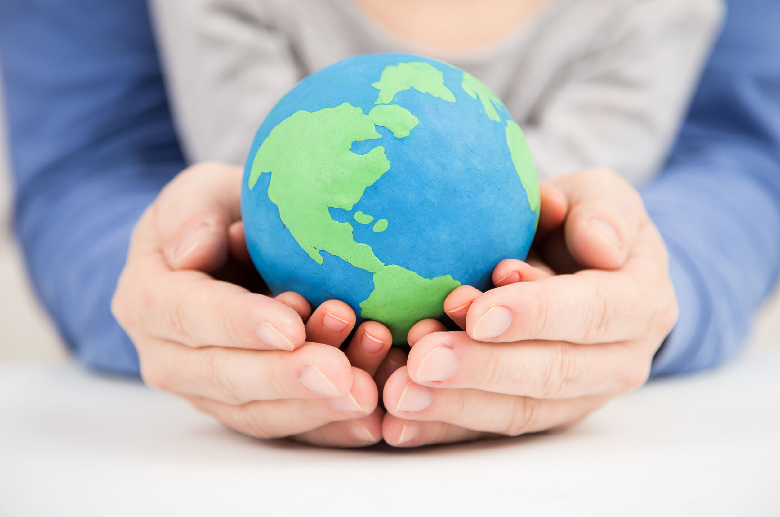 38962303 - father and daughter holding earth clay globe